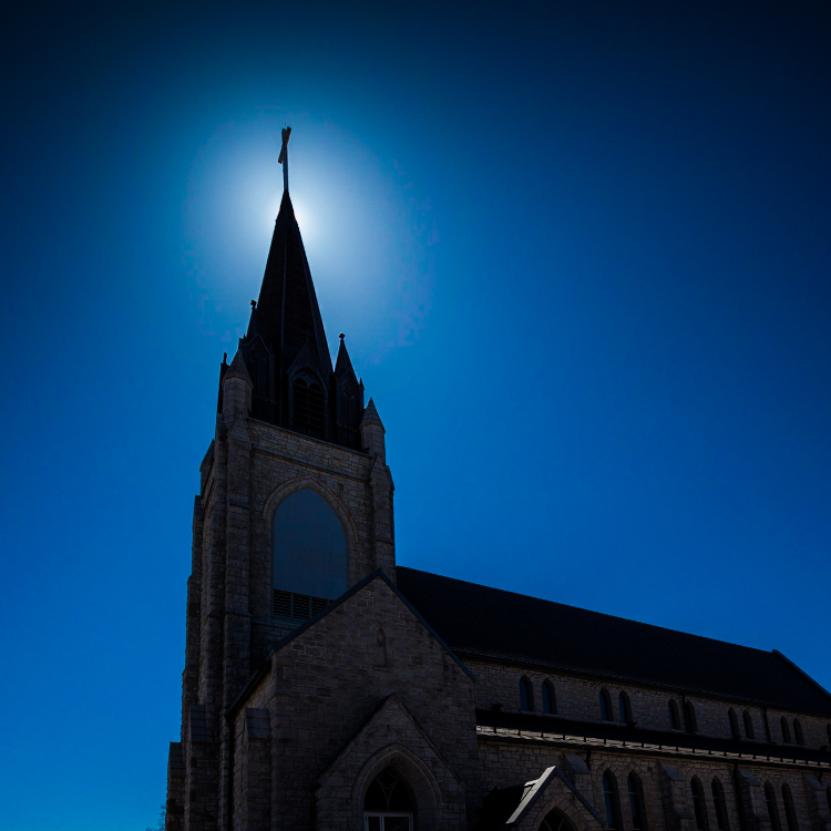 Guardian Angels Exterior with sun behind spire
